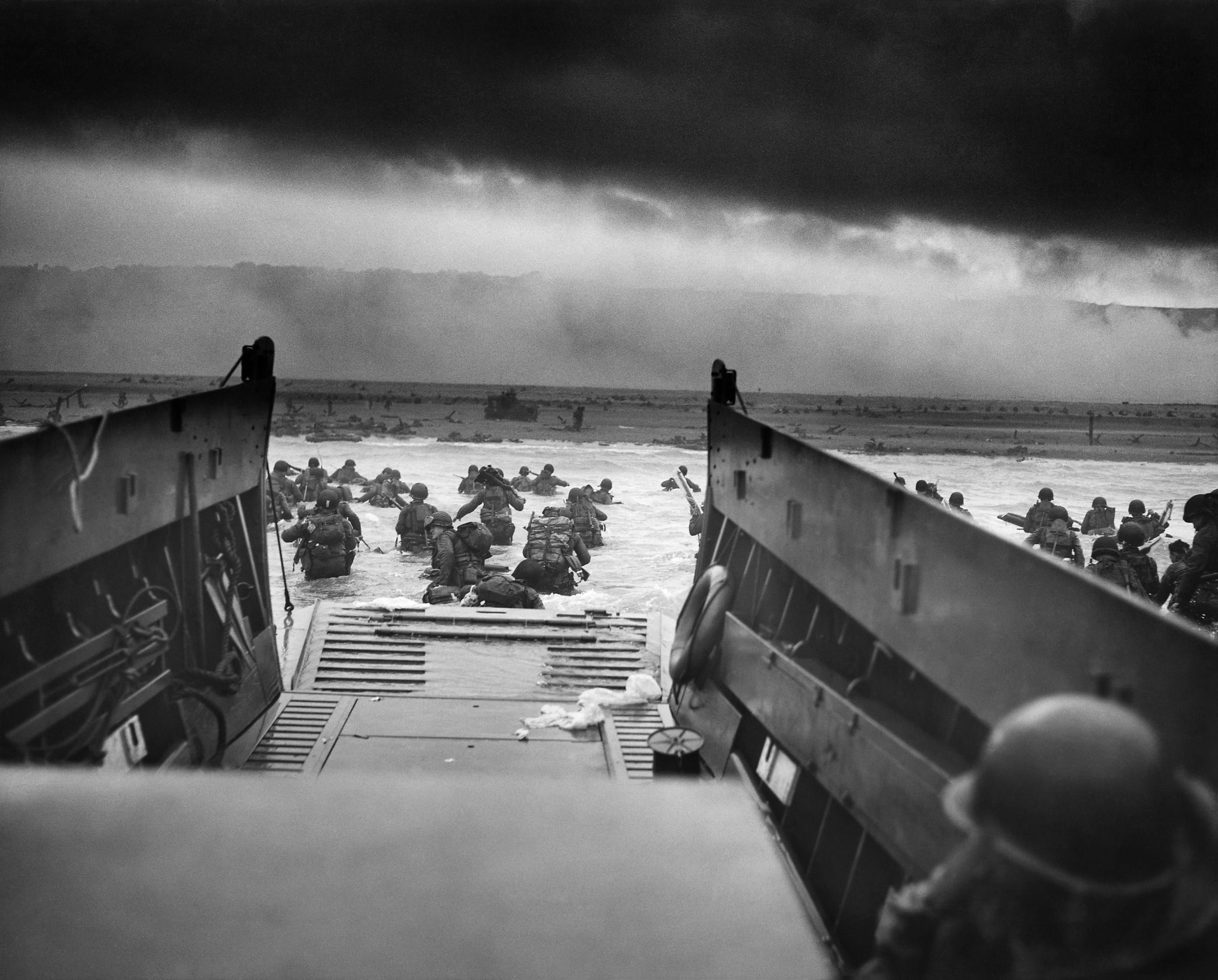 Image [June 6, 1944, an LCVP disembarks troops of Company E, 16th Infantry, 1st Infantry Division onto Omaha Beach in Normandy, France.]