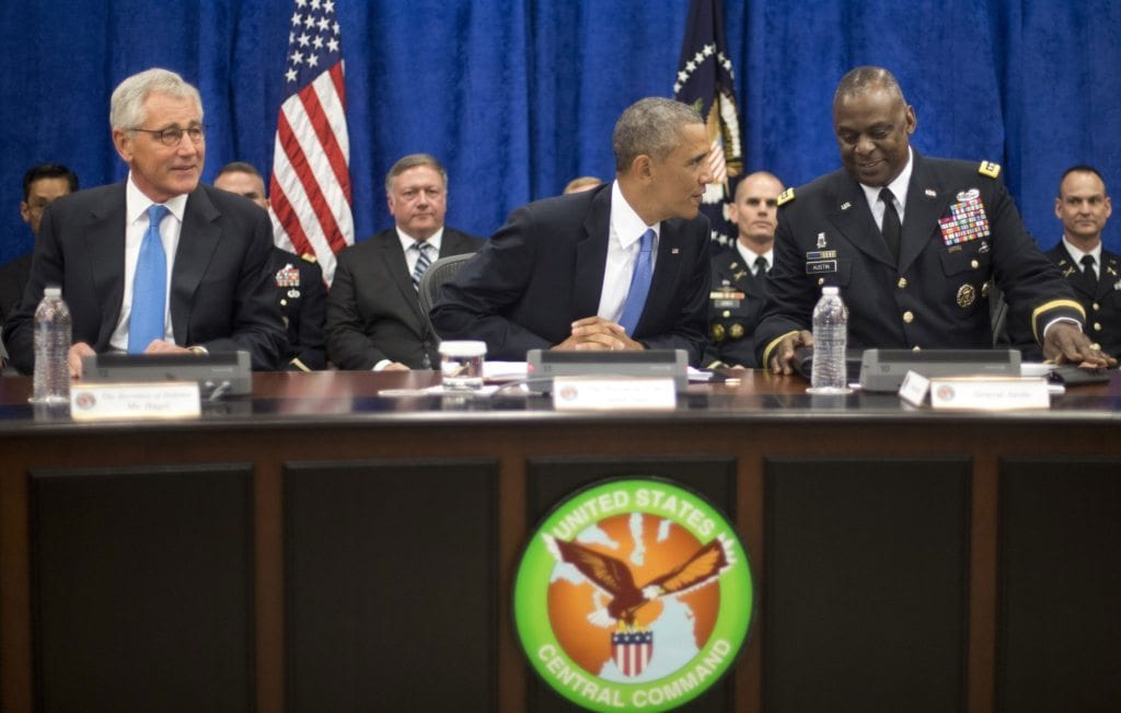 Secretary of Defense Chuck Hagel, left, President Barack Obama, and Gen. Lloyd J. Austin III, right [AP]