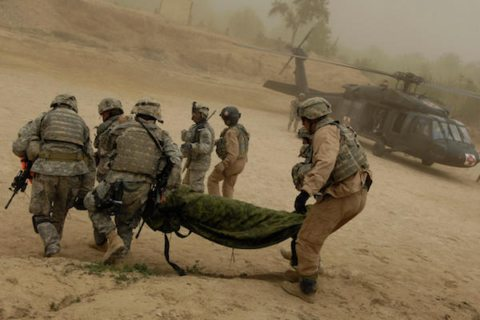 Image U.S. Army soldiers medically evacuate a wounded soldier.