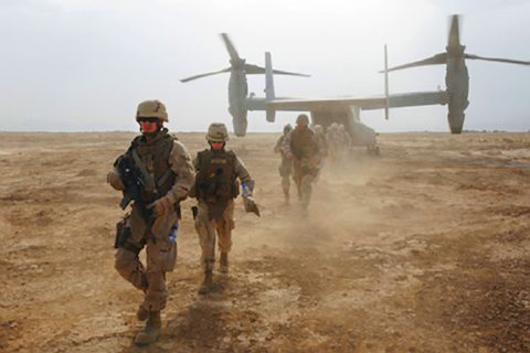 Image US Navy personnel disembark a V-22 Osprey