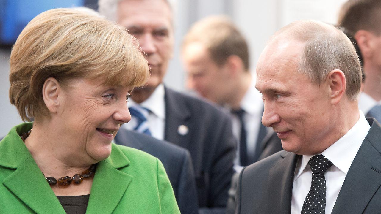 Image [German Chancellor Angela Merkel, Russian President Vladimir Putin (AFP)]