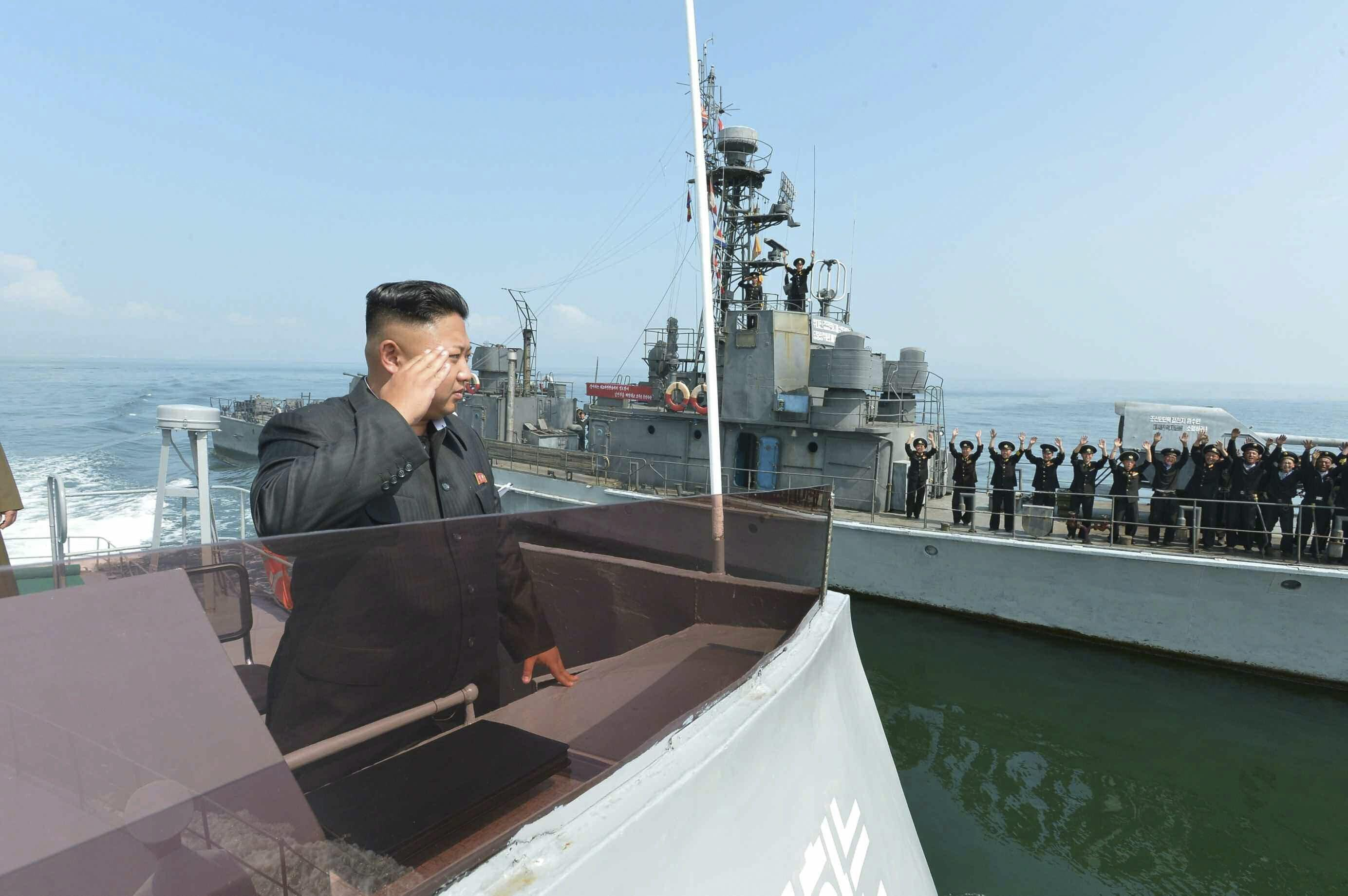 Image Kim Jong Un salutes during a landing drill of the Army Ground, Naval, Air and Anti-Air forces of the Korean People's Army (KPA) in this undated photo released by North Korea's Korean Central News Agency (KCNA) in Pyongyang July 5, 2014.