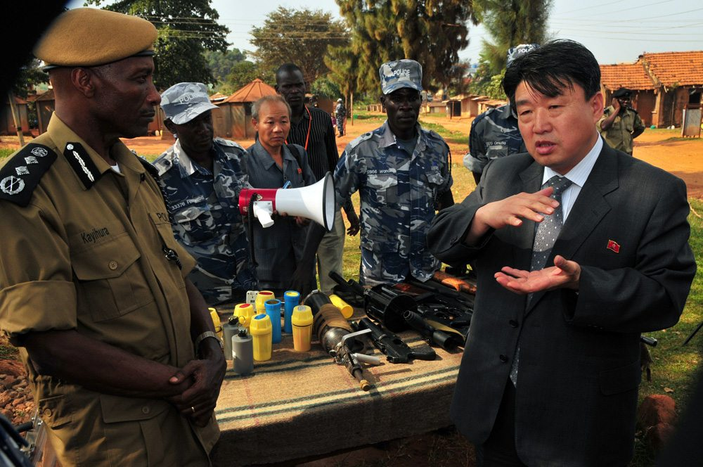 Image North Korean vice Minister of the the Ministry of Peoples Security, Mr. Ri Song, inspects weapons at a police training academy in Kampala, Uganda, June 13, 2013 (AFP/Stringer)