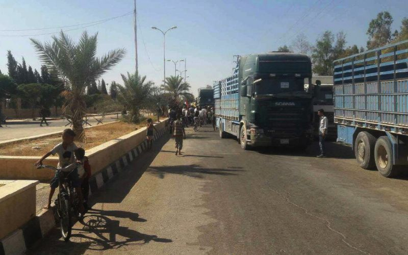 Image A handout picture released by the Syrian Arab News Agency (SANA) shows trucks carrying food aid arriving in Deir Ezzor on September 7, 2017, as the first supplies since government troops broke a jihadists siege were delivered (AFP Photo/HO)
