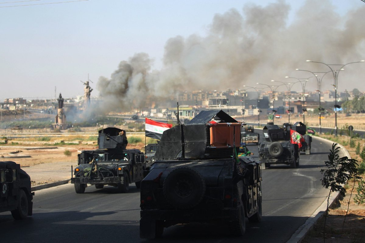Image Iraqi forces advance toward the center of Kirkuk during an operation on Oct. 16. (Photo by AFP)