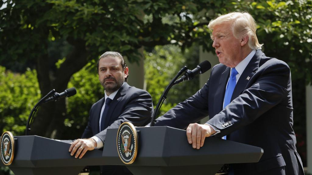 Image US President Donald Trump holds a news conference with Prime Minister of Lebanon Saad Hariri, July 25, 2017 (AP)
