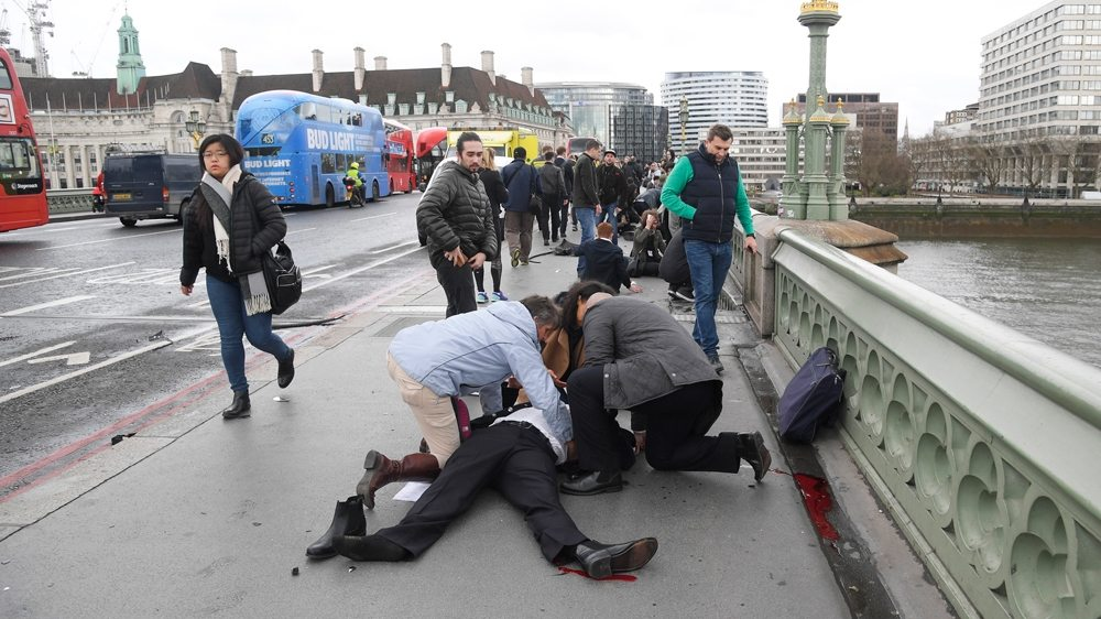 Image Injured people are assisted after the attack on Westminster Bridge [Toby Melville/Reuters]