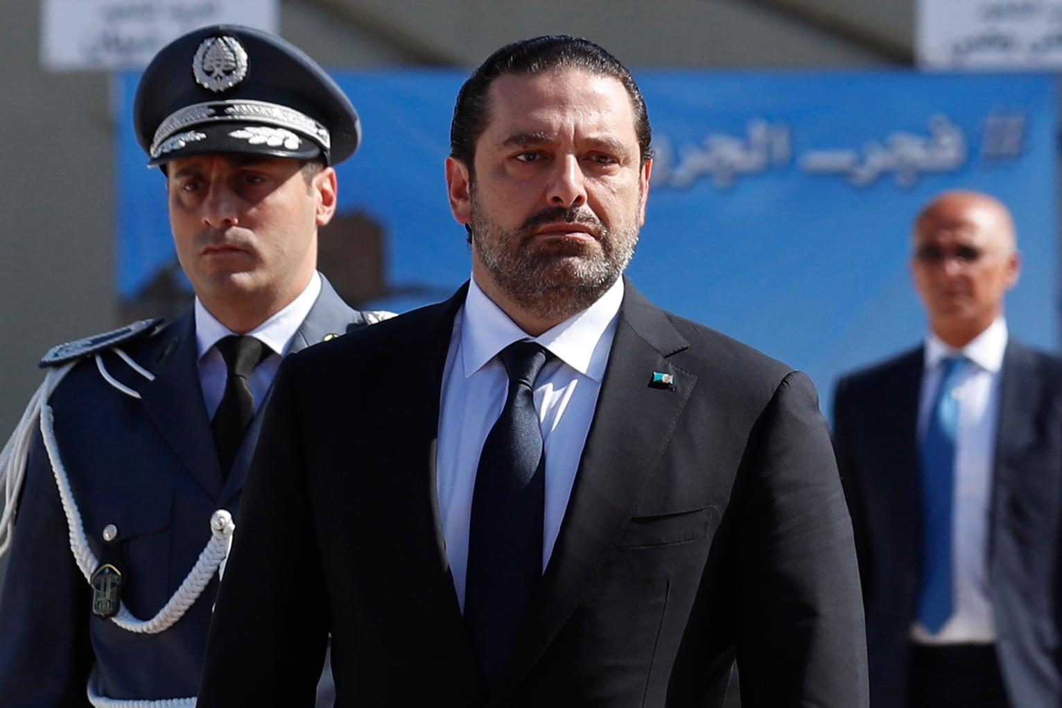 Image Lebanese Prime Minister Saad Hariri, left, arrives for a mass funeral of ten Lebanese soldiers at the Lebanese Defense Ministry, in Yarzeh near Beirut, Lebanon, Sept. 8, 2017 (Hassan Ammar/Associated Press)