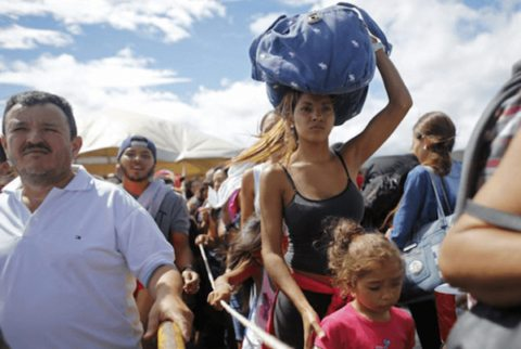 Image Venezuela's mass exodus continues as Maduro opposition vows to boycott presidential election [Image: ARIANA CUBILLOS / AP]