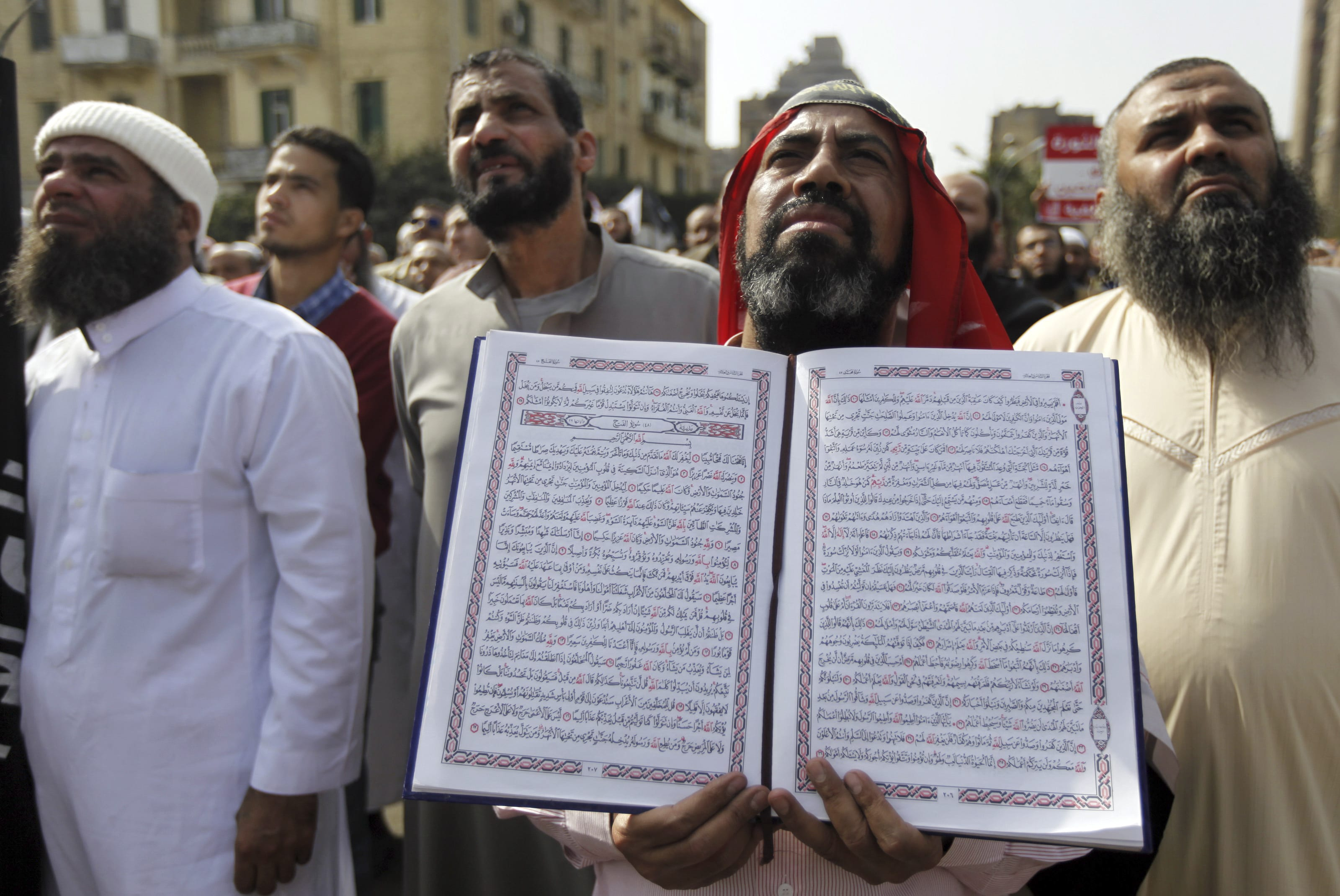 Image An Egyptian Salafi Muslim man holds a copy of the Koran during a protest in support of police officers who were suspended from work because of their beards, Cairo, March 1, 2013 (REUTERS/Amr Abdallah Dalsh).