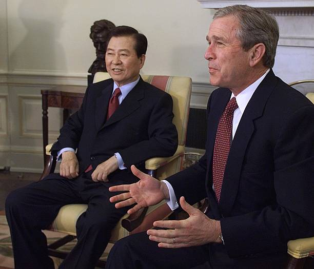 Image George W. Bush meets with South Korean President Kim Dae Jung March 07, 2001 [AFP PHOTO/Luke FRAZZA]