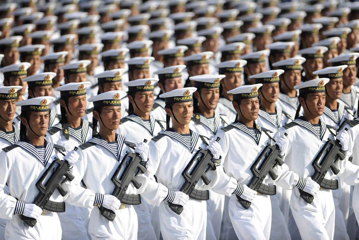 Image Members of the Chinese People's Liberation Army Navy march in formation during a training session at the 60th National Day Parade Village on the outskirts of Beijing, on September 15, 2009 [Joe Chan / Reuters]