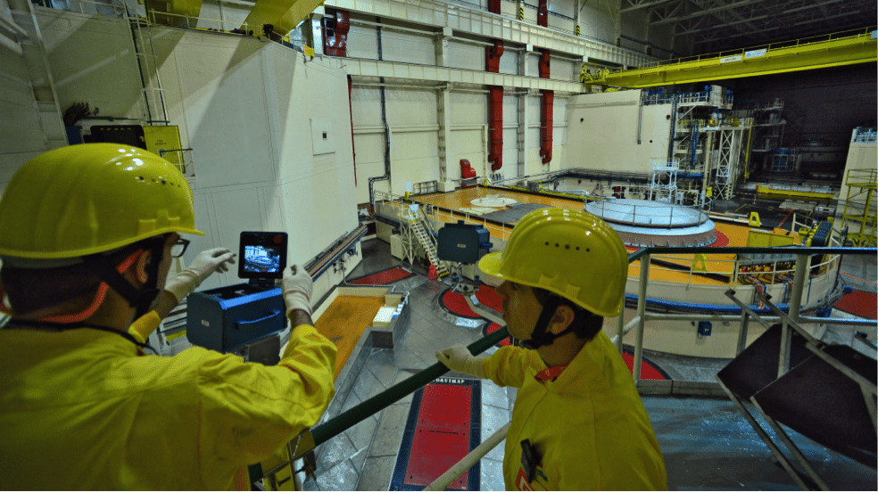 Image (IAEA Inspectors monitoring nuclear materials)