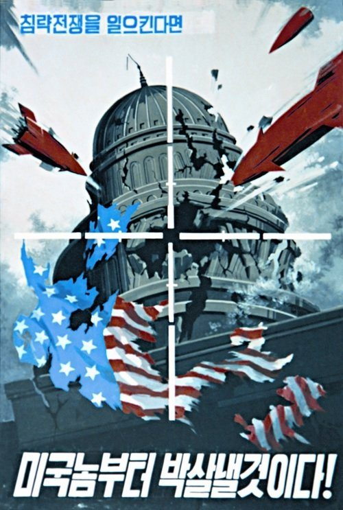 "Image [North Korean propaganda poster with the caption ""When provoking a war of aggression, we will hit back, beginning with the U.S.""]"