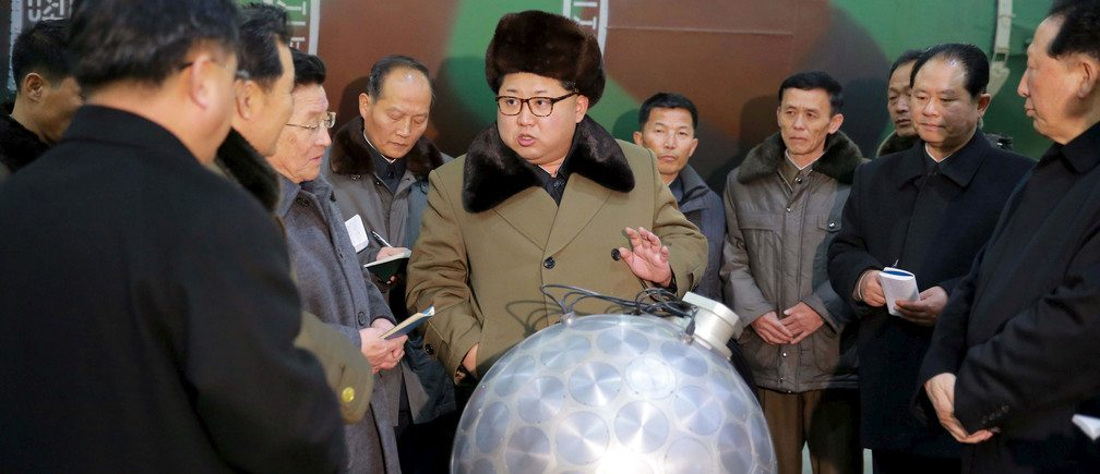 "Image Kim Jong Un reviewing a ""miniaturized"" nuclear device. Although North Korean press claimed it to be a functional device, it may just be a model. (Image by North Korean state newspaper the Rodong Sinmun)"