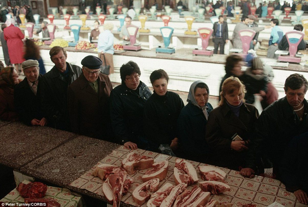 Image A long queue forms in Novokuznetsk for bacon and other meat from the butcher at a state-run market [Peter Turnley / Corbis]