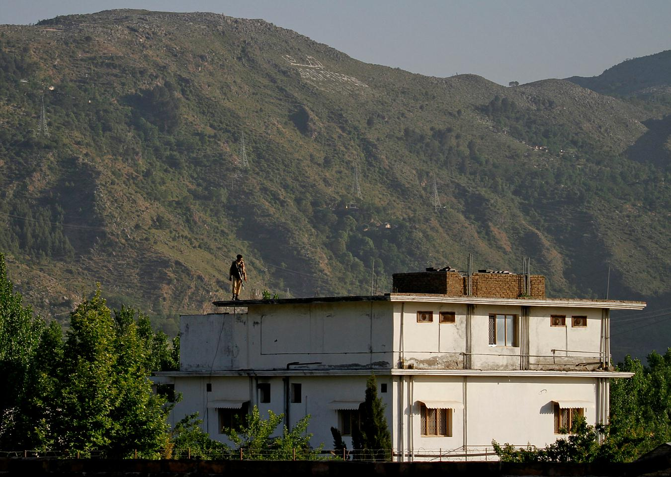 Image A Pakistani army soldier stands on the roof of the compound in Abbottabad, Monday, May 2, 2011. (AP Photo/Anjum Naveed)
