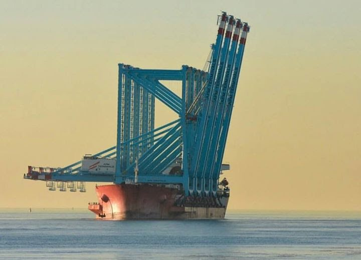 Image [The Zhen Hua 20 in Brooklyn, New York, loaded with four container cranes from Shanghai, China to Elizabeth, New Jersey. Ships like this one can carry up to 6 fully tested container cranes and heavy components.]