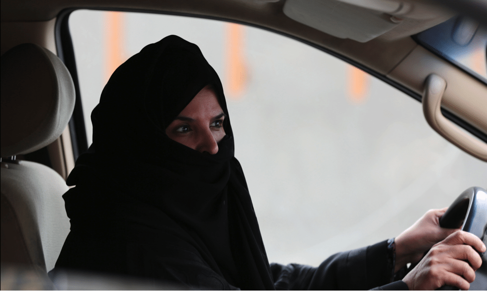 Image Aziza Yousef participates in a campaign defying the ban on women's driving by driving a car on a highway in Riyadh in 2014 [Image: AP]