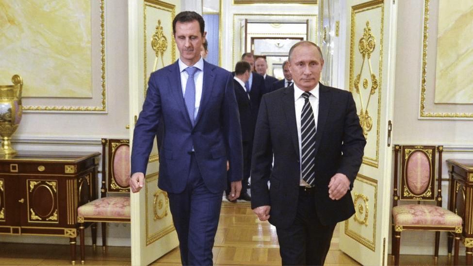 Image [Russian President Vladimir Putin and Syrian President Bashar al Assad meeting in Moscow. (AP photo)]