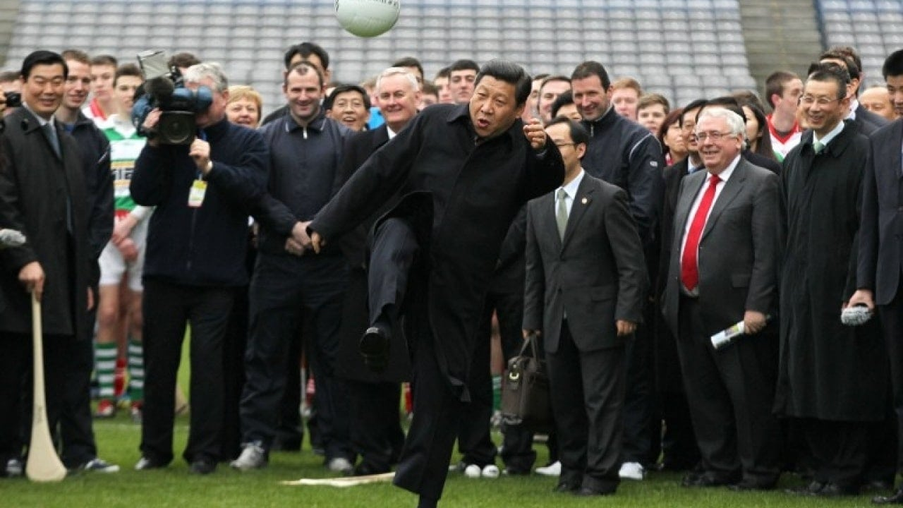 Image [Then Chinese Vice President Xi Jinping kicks a Gaelic football as he visits at Croke Park in Dublin, Ireland, February 19, 2012. (PETER MUHLY/AFP)]
