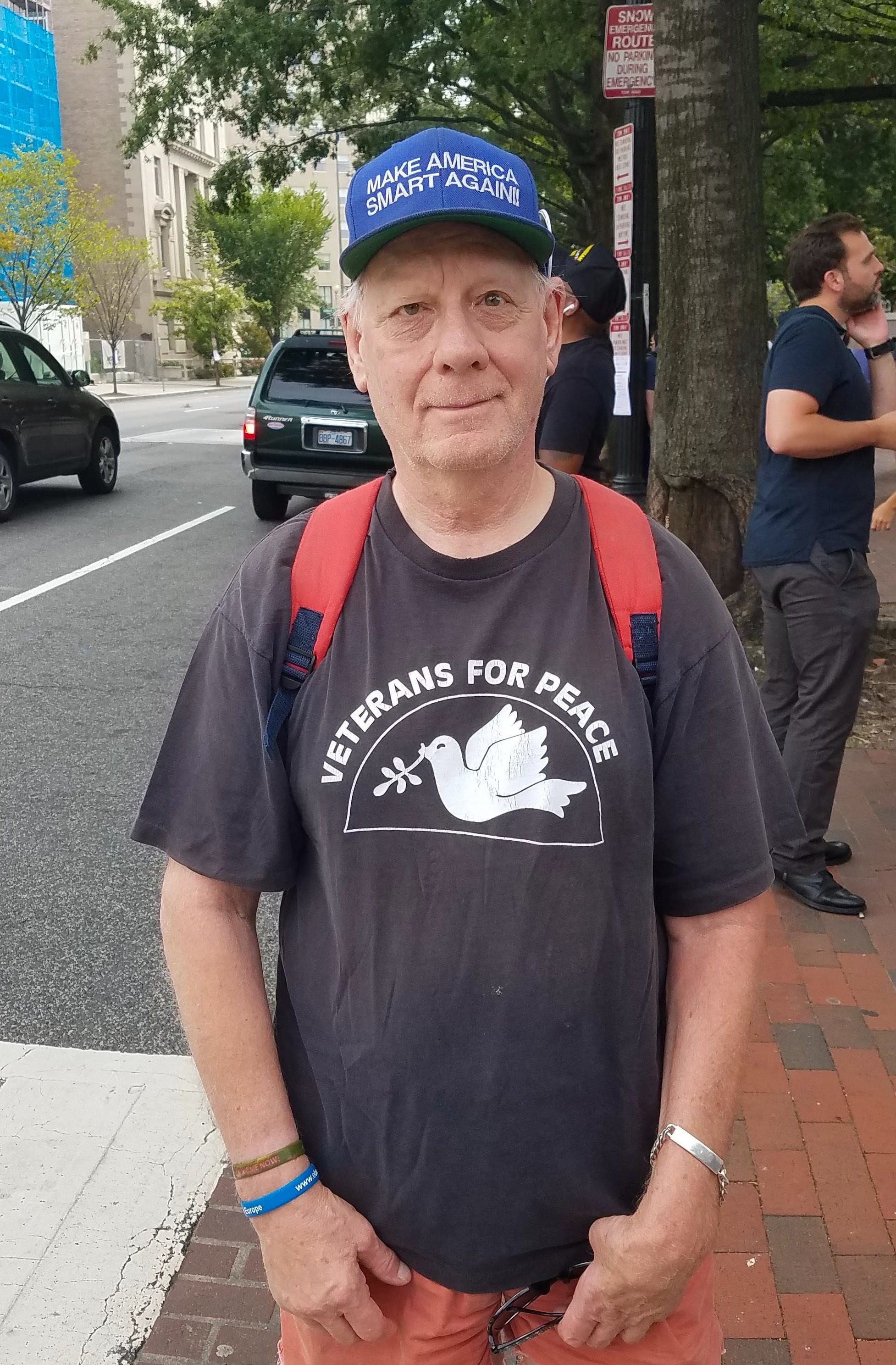 Image [Michael Marceau, President of Veterans for Peace, an Army combat veteran who was critically injured in Vietnam, came to protest at the Unite the Right 2 rally, Washington D.C., August 12, 2018][Photo: Alex Kish]