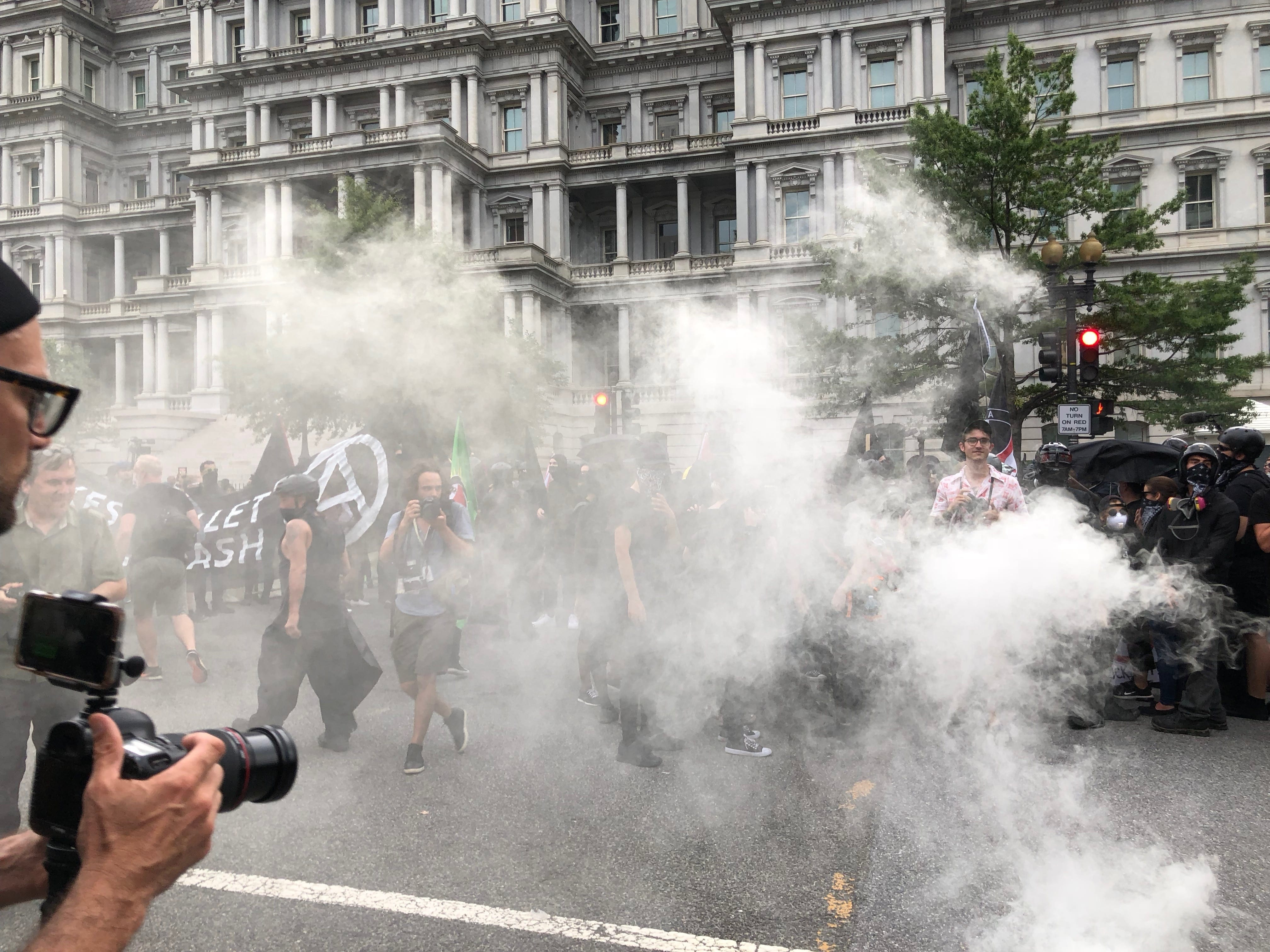 Image [A smoke bomb is thrown into counter-protest, Unite the Right 2 rally, Washington, D.C., August 12, 2018][Photo: Anthony A. LoPresti / Lima Charlie News]