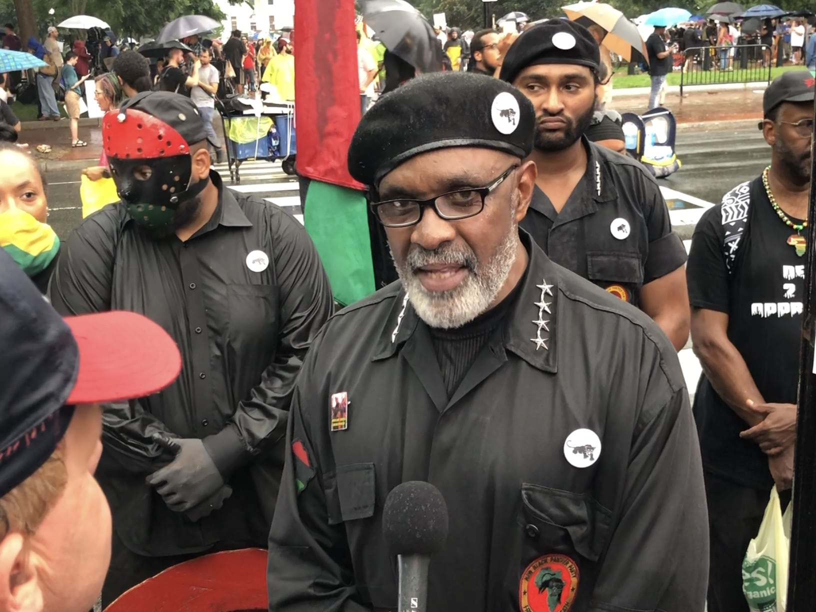 Image [Imam Akbar, Former National Minister Of Justice at The New Black Panther Party, came to protest at the Unite the Right 2 rally, Washington, D.C., August 12, 2018][Photo: Anthony A. LoPresti / Lima Charlie News]