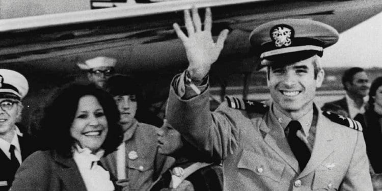 Image [Then Lt. Cdr. John S. McCain III, a POW for over five years, waves to well wishers after arriving at Jacksonville Naval Air Station in Florida in this March 18, 1973][AP Photo]