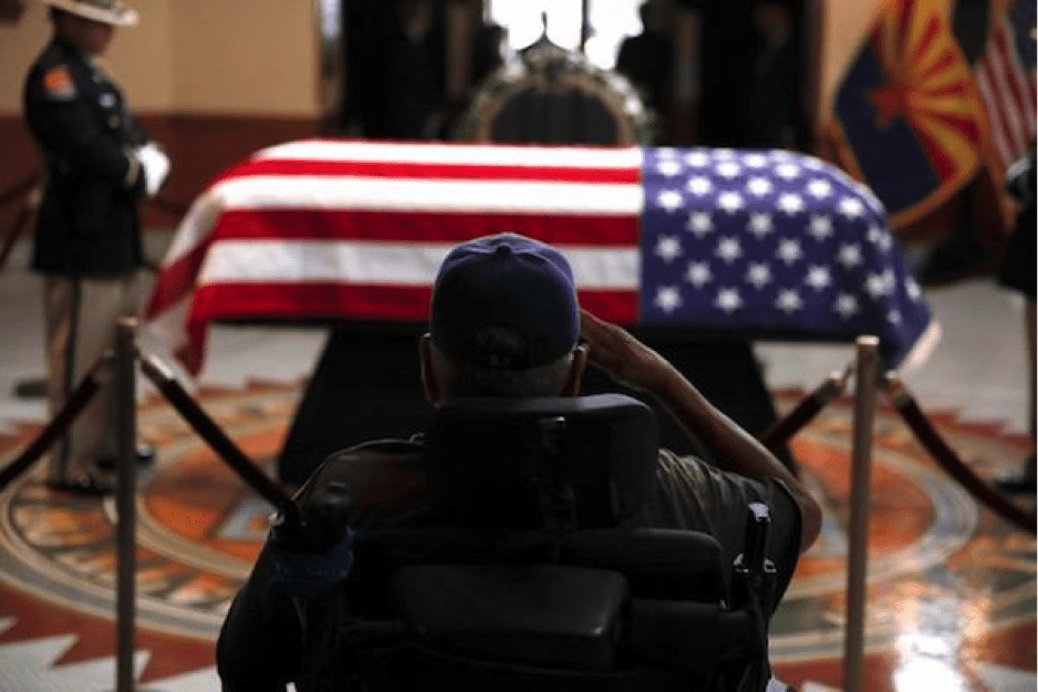 Image [Former serviceman saluting McCain's casket at the memorial service in the Arizona state capitol. AP Photo / Jae C. Hong, Pool]