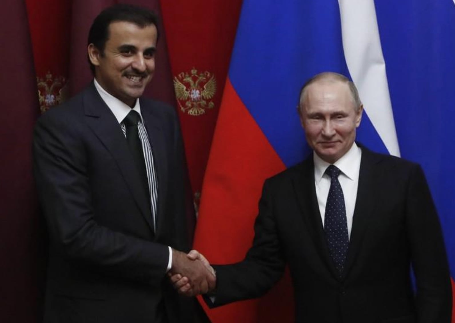 Image Russian President Vladimir Putin and Qatar's Emir Sheikh Tamim bin Hamad al-Thani shake hands during a signing ceremony following a meeting at the Kremlin in Moscow, Russia March 26, 2018. [REUTERS / Sergei Karpukhin]
