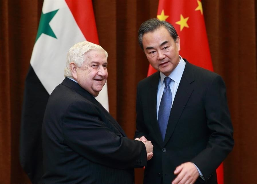 Image [Chinese Foreign Minister Wang Yi (R) holds talks with Syrian deputy prime minister and foreign minister Walid al-Moallem in Beijing, capital of China, Dec. 24, 2015 (Xinhua / Ding Haitao)]
