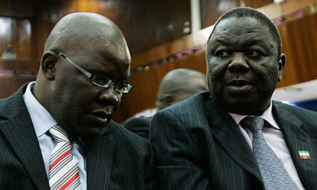 Image Morgan Tsvangirai (l) and Tendai Bitti, April 12, 2008, attend opening session of Southern African Development Community (SADC) in Lusaka, Zambia (Photo: Gianluigi Guercia)