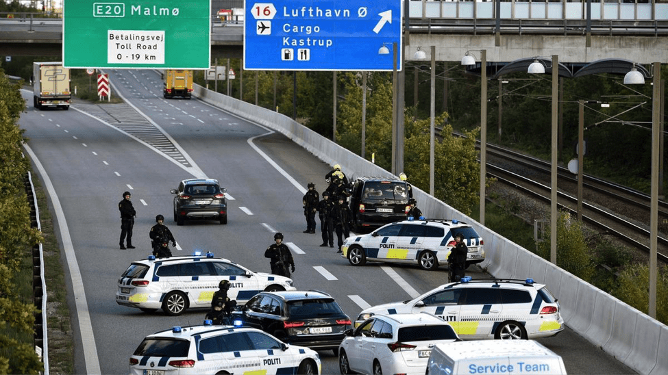 Image Danish police on Sept. 28, blocking a road as part of a nationwide operation to prevent an expected attack. (EPA image)