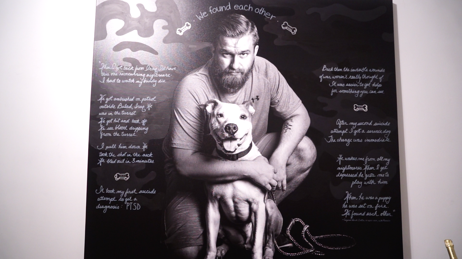 """Image [A veteran and his service dog. When the dog was assigned service, he had been severely burned in an act of animal abuse. They were able to heal together. Depicting the Invisible"""" at HG Contemporary gallery, November 9, 2018][Photo: Diego Lynch]"""