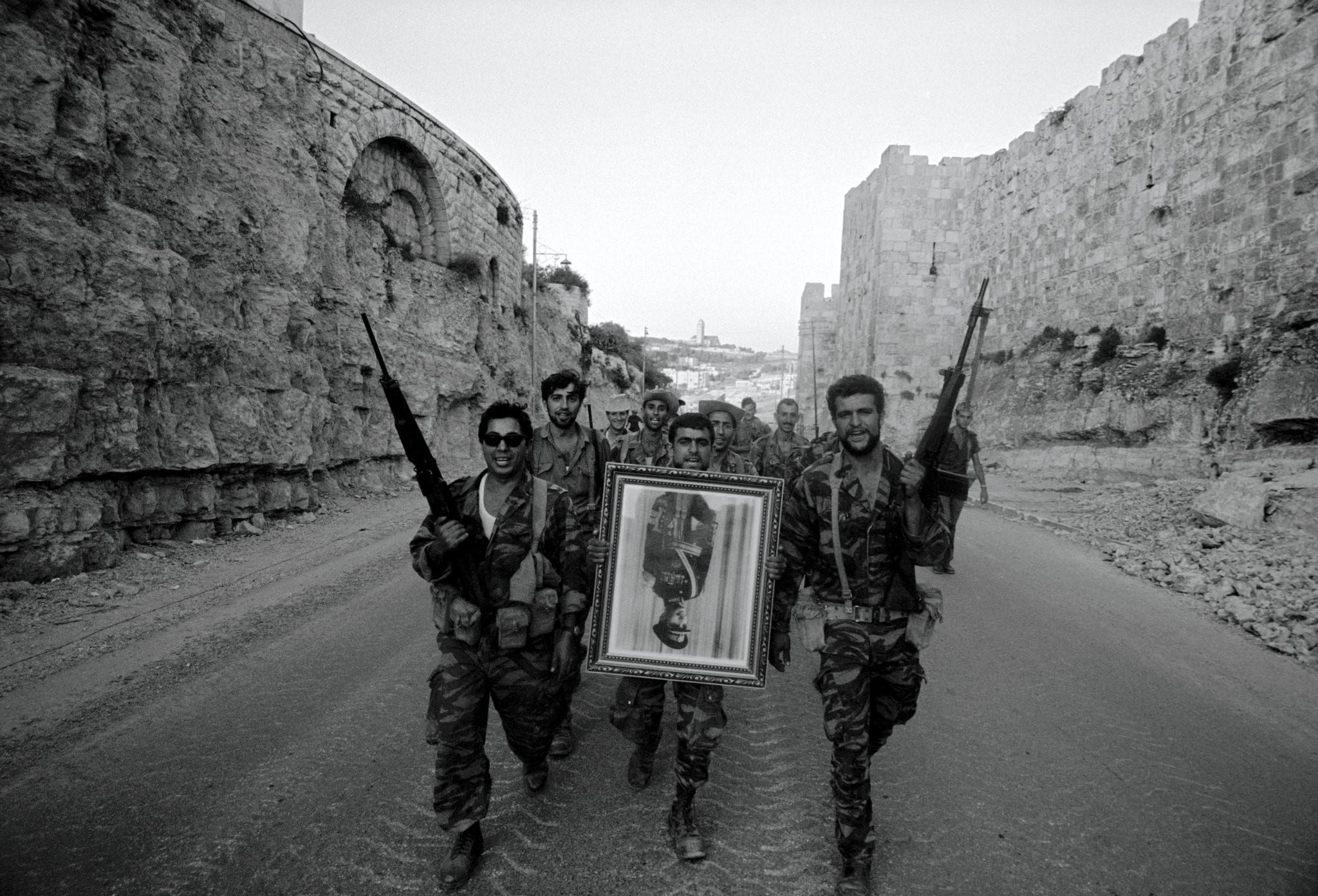 Image [After Israel seized East Jerusalem in 1967, its soldiers carried a confiscated portrait of King Hussein of Jordan. Credit: Leonard Freed / Magnum Photos]