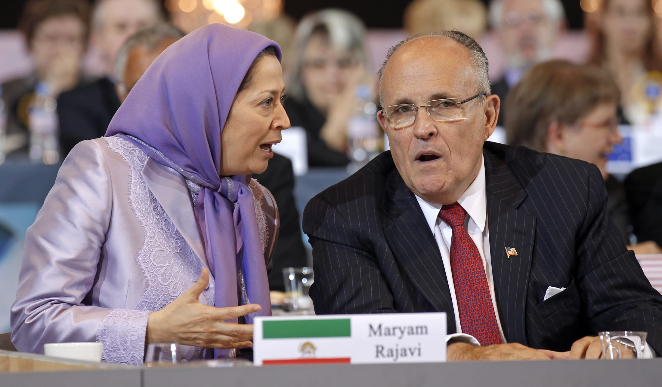 Image Maryam Rajavi, president-elect of the People's Mujahideen Organisation of Iran's (PMOI) political wing, the National Council of Resistance of Iran (NCRI) and former mayor of New York Rudy Giuliani take part in a rally in Villepinte, near Paris June 18, 2011. [REUTERS / Benoit Tessier]