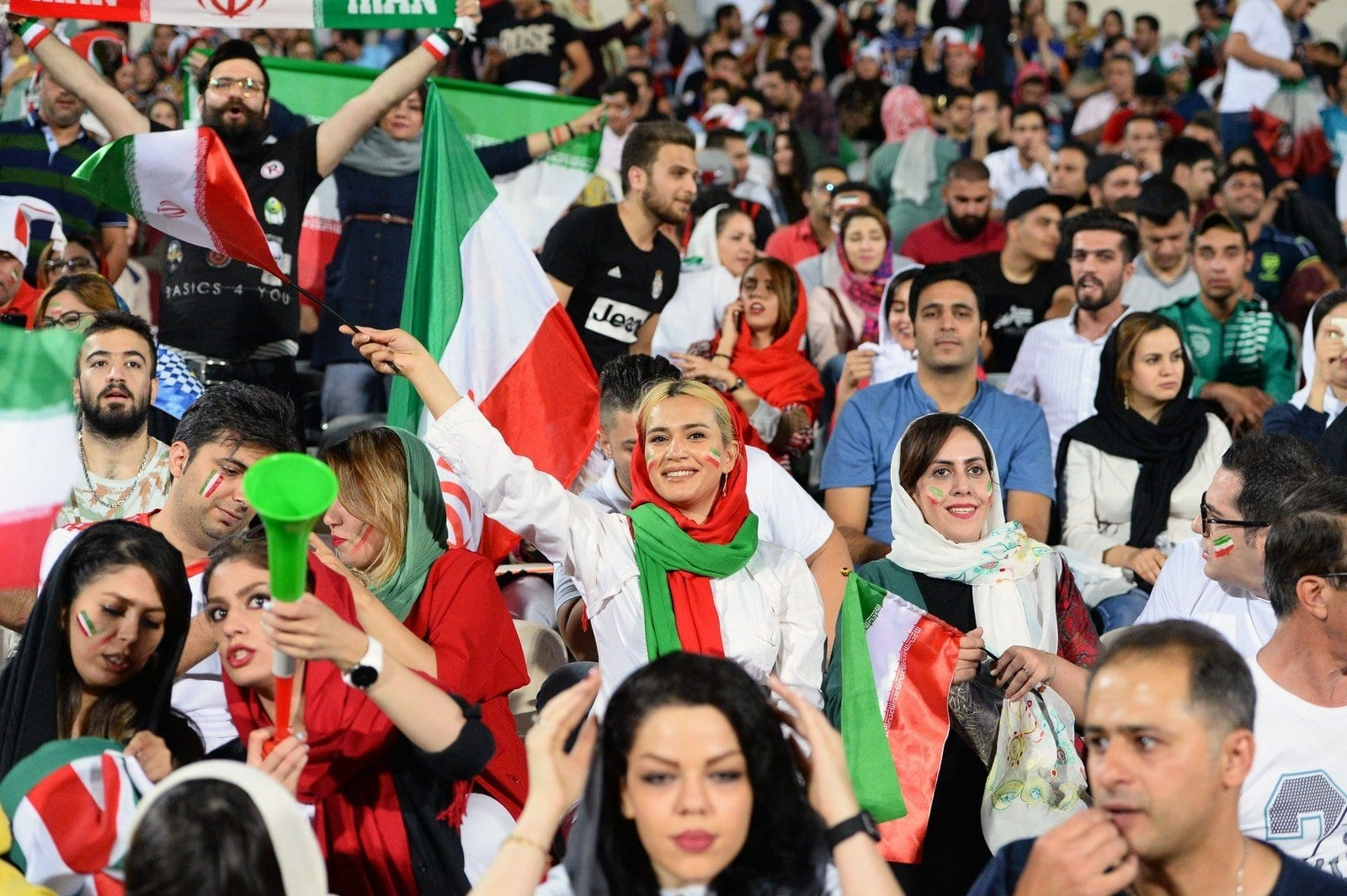 Image [A diverse crowd of Iranians in Tehran watch the World Cup after a 40 year prohibition against women attending public sporting events. June 20, 2018, Azadi Stadium, Tehran. (ANADOLU AGENCY)]