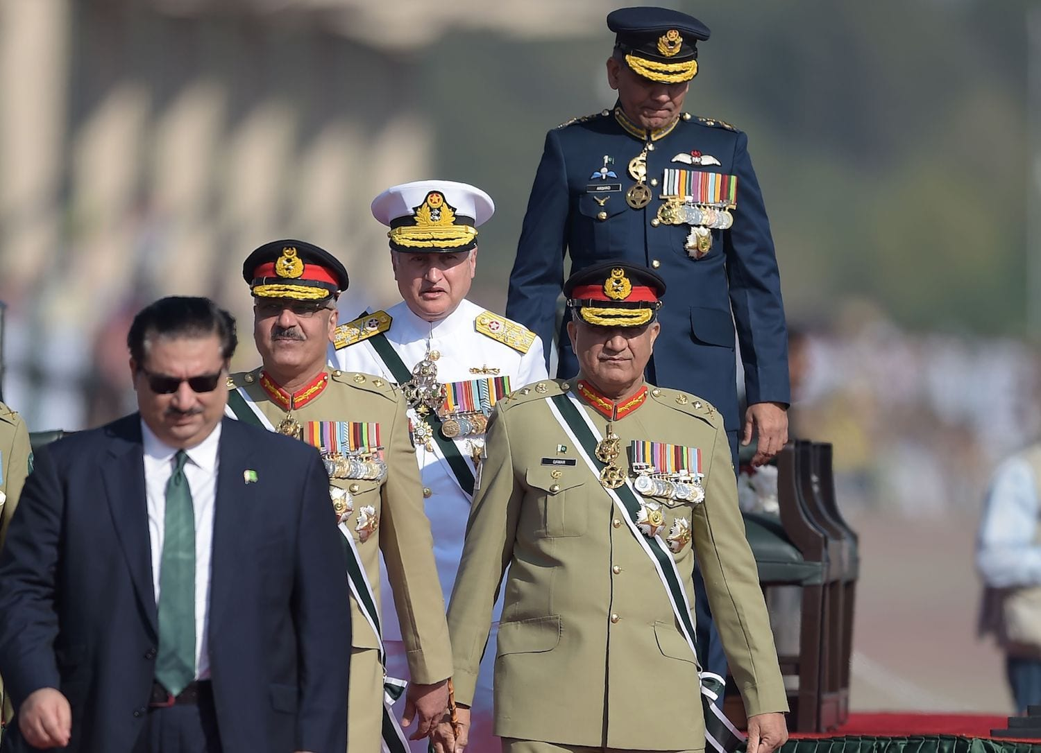Image [Pakistani Army Chief General Qamar Javed Bajwa (2R), Pakistani Chief of Naval Staff Admiral Zafar Mahmood Abbasi (C), Pakistani Air Chief Marshal Mujahid Anwar Khan (top-R) and Pakistani Chairman of the Joint Chiefs of Staff Committee Zubair Mahmood Hayat (2L) arrive to receive Sri Lankan President Maithripala Sirisena during the Pakistan Day military parade in Islamabad on March 23, 2018. (Photo: Aamir Qureshi / AFP)