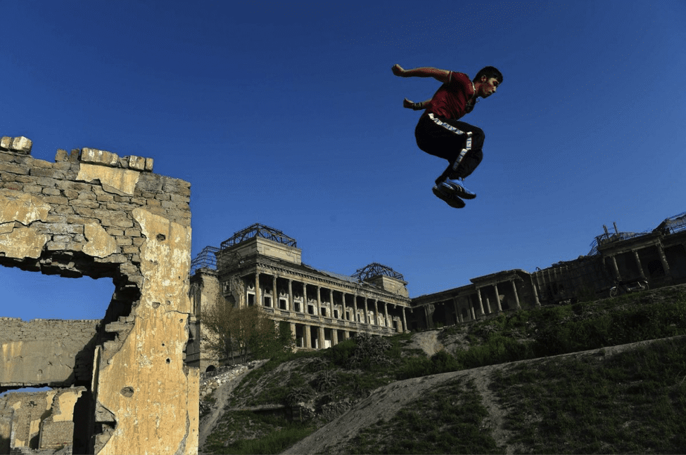 Image An Afghan youth practices his parkour skills in the ruins of Darul Aman Palace. (Image by Wakil Kohsar)