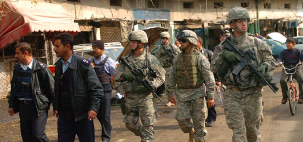 Image [Iraqi police and paratroopers from 2d BCT, 82d Airborne Division, patrol Adhamiyah, February 17, 2007][Source: U.S. Army Photo by Staff Sergeant Michael Pryor (Released)]