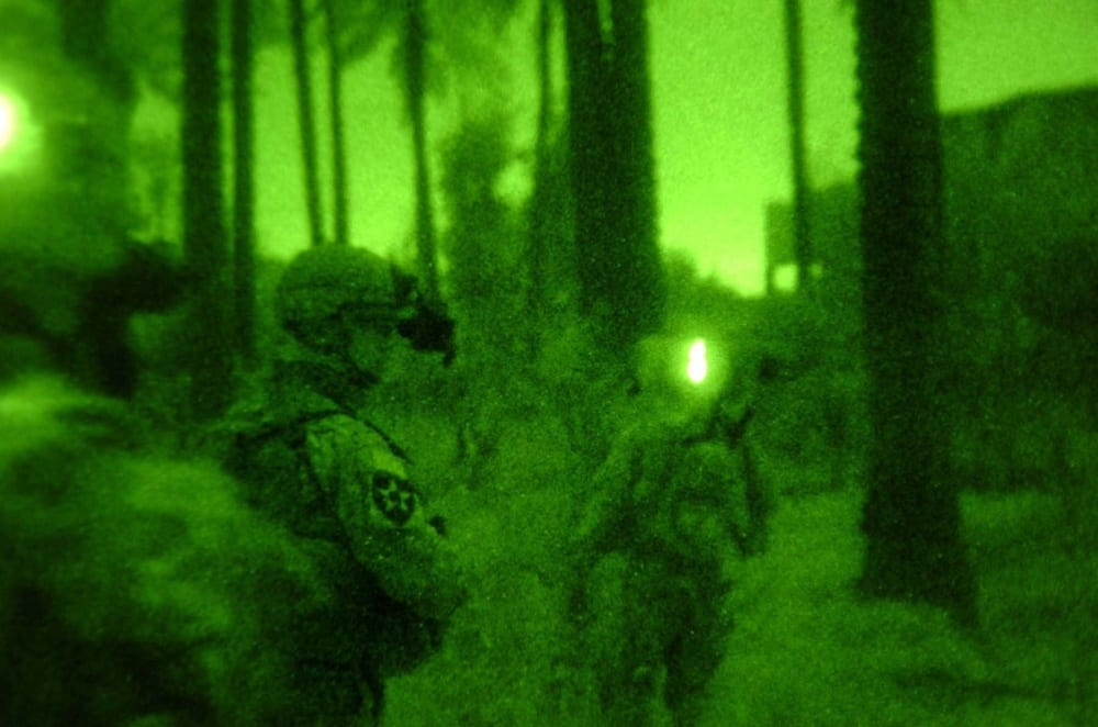 Image [Soldiers move through the outskirts of palm groves in Baqubah, Iraq, during a night mission March 25, 2007][Source: DoD photo courtesy 5th Mobile Public Affairs Detachment (Released)]