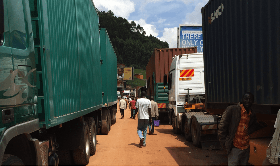 Image [Trucks at the Rwanda/Uganda Border. Uganda impounded Rwandan trucks at this border in November 2018 while transporting minerals worth $750,000. (AmarinAfrica photo via Wikicommons)]