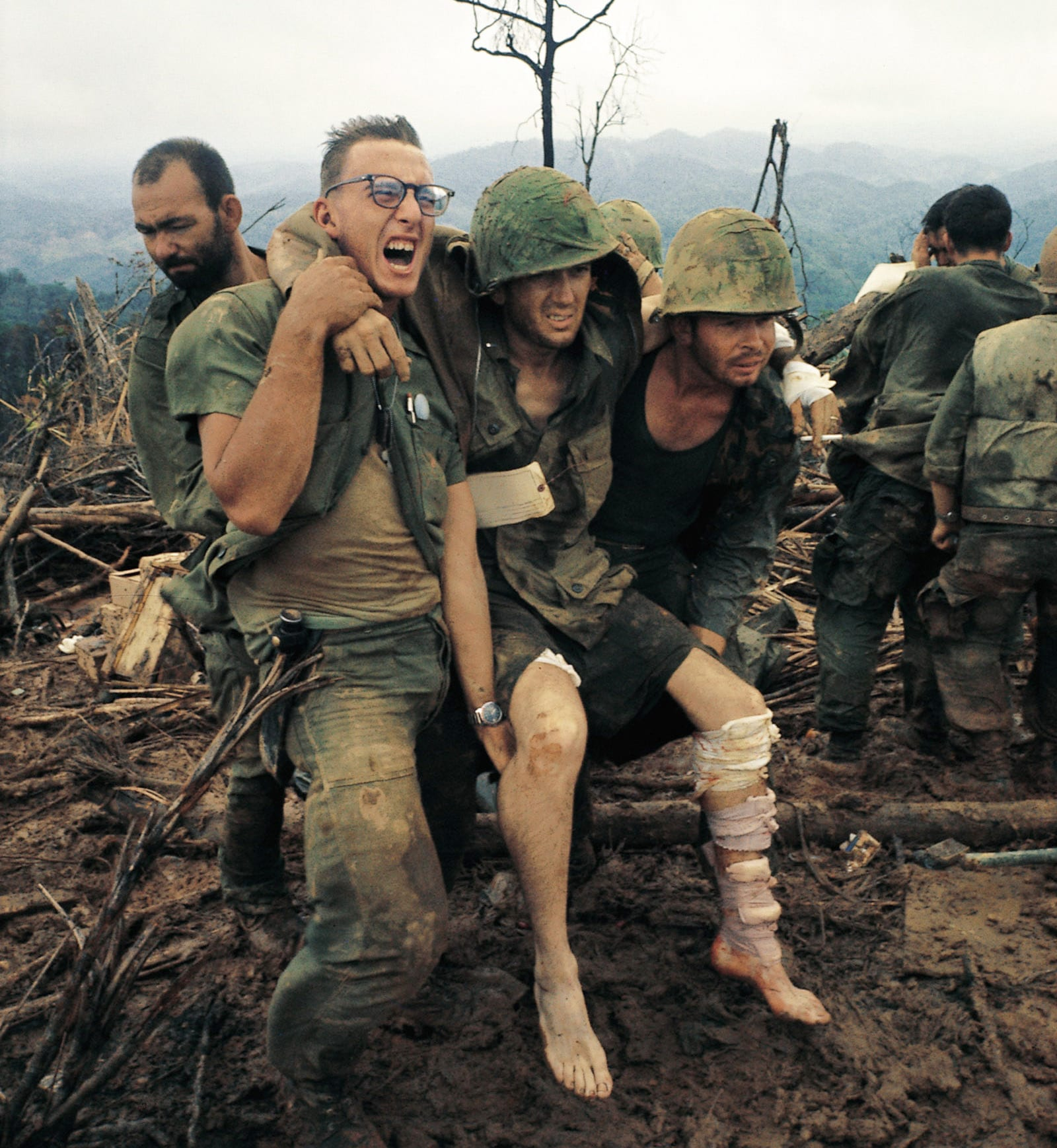 Image [US Marines with an injured comrade at a first-aid station, Mutter's Ridge, Nui Cay Tri, South Vietnam, October 1966][Photo: Larry Burrows]