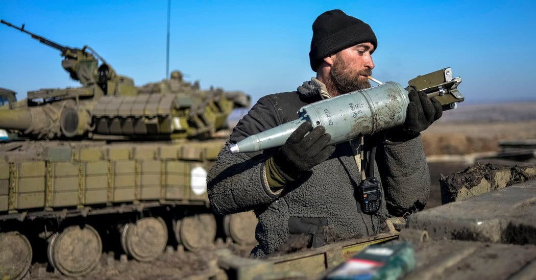 Image [A Ukrainian soldier loads a tank with shells near Donetsk. (Photo: Alexei Chernyshev / Reuters]