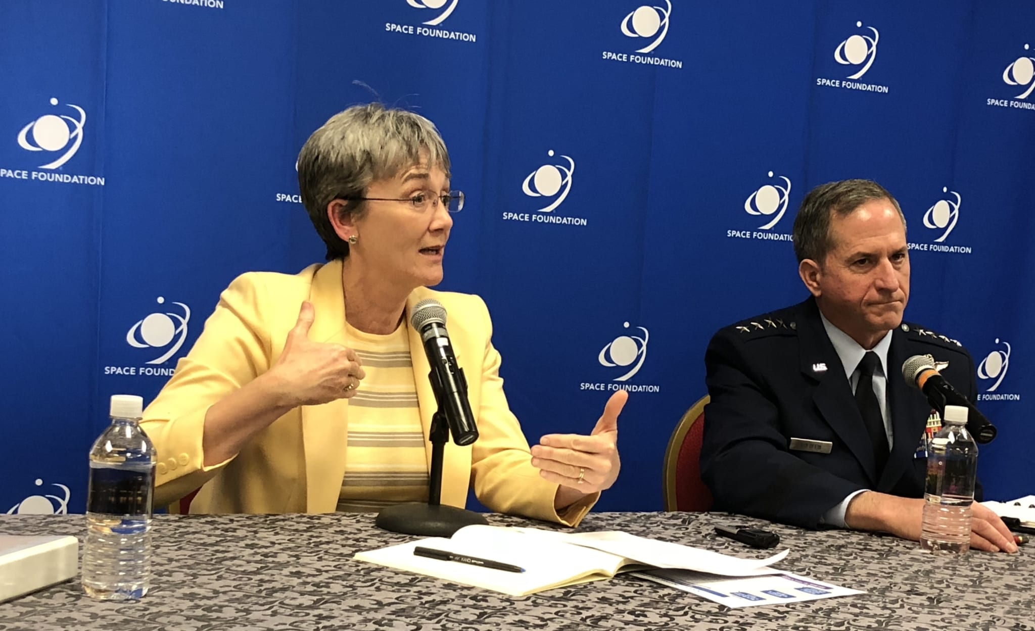 IMage Secretary of the U.S. Air Force Heather Wilson and USAF Gen. David L. Goldfein at the 34th Space Symposium in 2018.