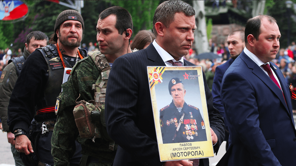 "Image [The traditional ""Immortal Regiment March"", Donbass, 2017. The event was held under the motto ""Legends never die"". Note the presence of the leader of ""The Night Wolves"" - Alexander Zaldostanov (i.e. ""The Surgeon"") behind the late leader of the DNR Alexander Zaharchenko)]"