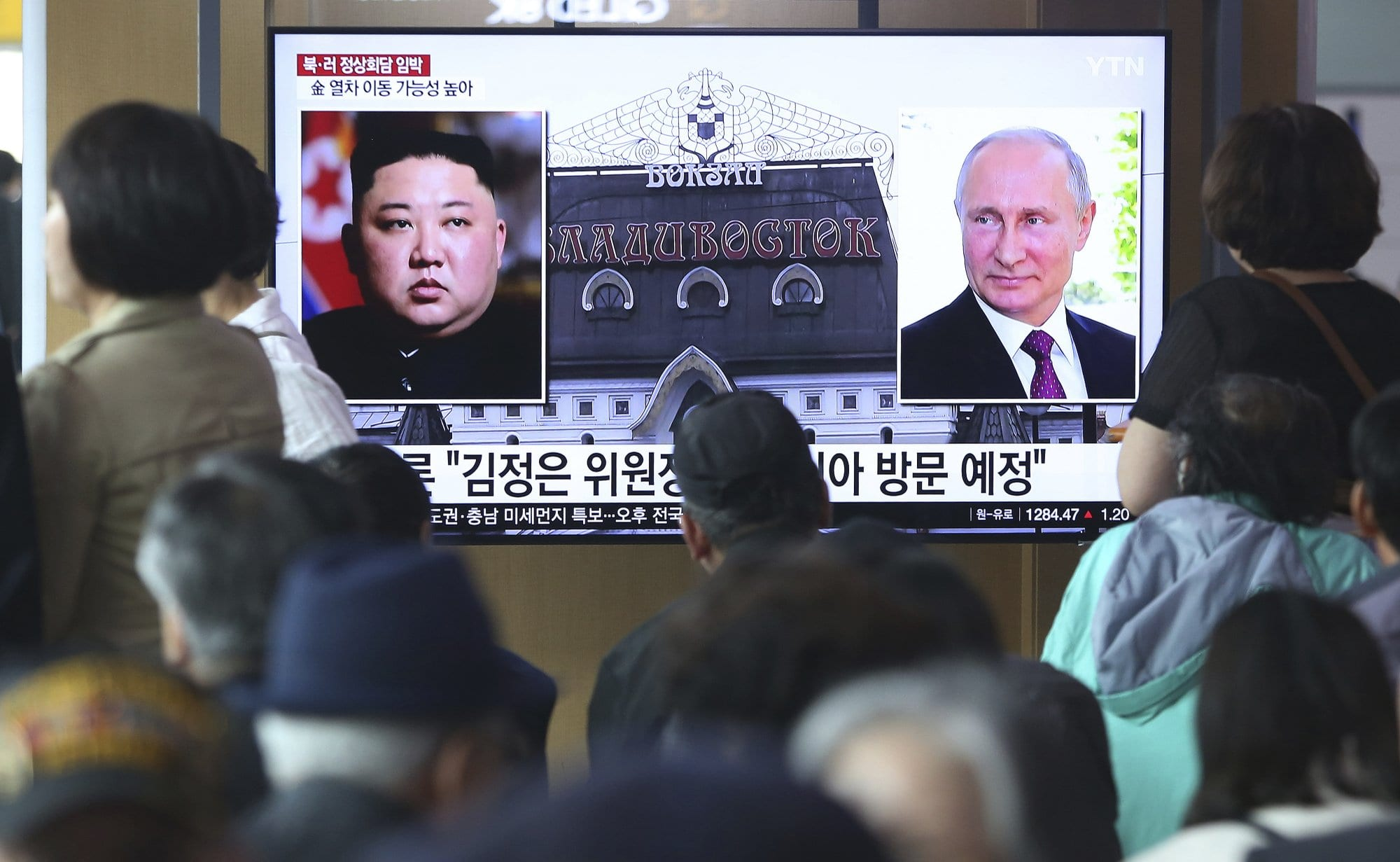 "Image [People watch a TV screen showing images of North Korean leader Kim Jong Un and Russian President Vladimir Putin during a news program at the Seoul Railway Station in Seoul, South Korea, days before their summit meeting on April 24-25, 2019. The Korean letters on the screen read, ""Kim Jong Un plans to visit Russia ."" (Photo Ahn Young-joon / AP)]"