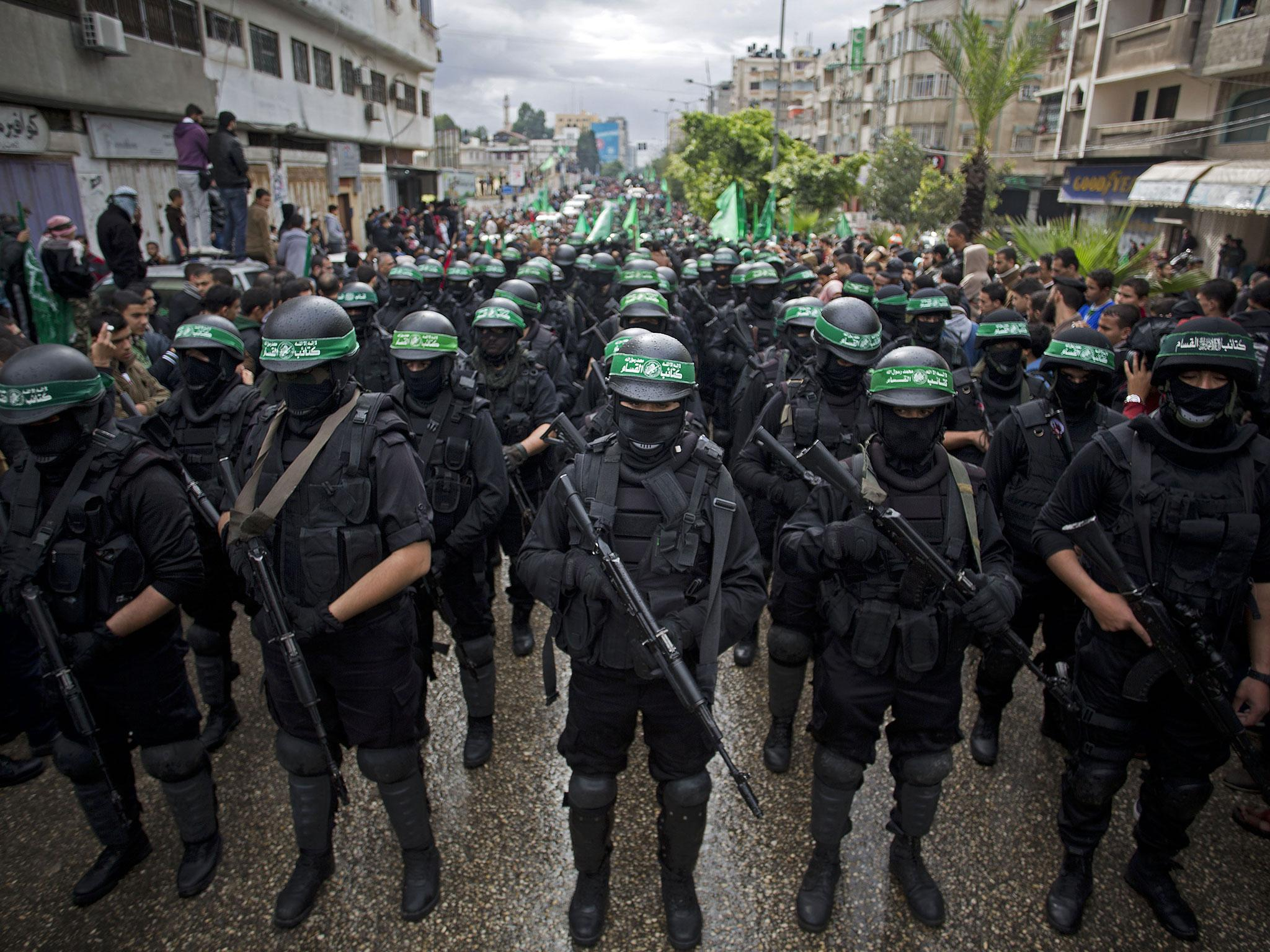 Hamas gunmen display their military skills during a rally to commemorate the 27th anniversary of the militant group ( AP )